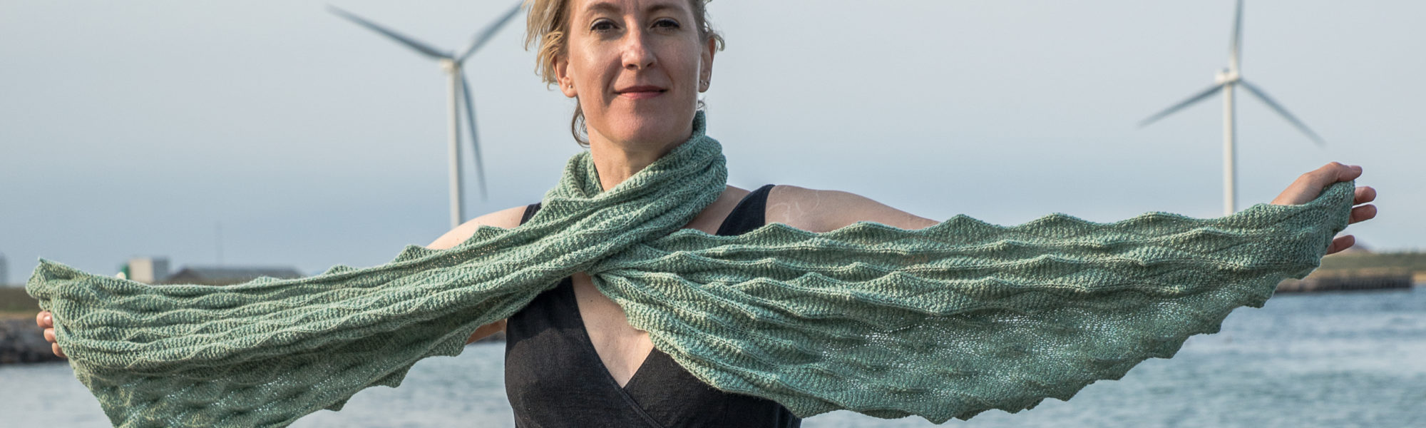 A rectangular scarf featuring an interesting, fun and very textural 3D type pattern in a mainly garter stitch base.